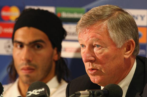 Alex Ferguson and Carlos Tevez during the player's Manchester United days. Photo: Getty Images