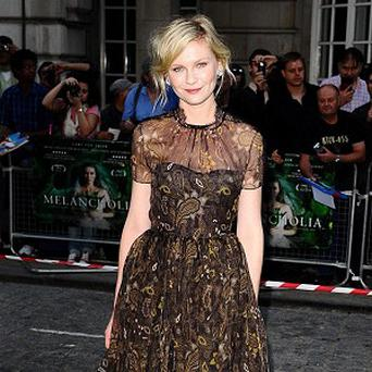 Kirsten Dunst arriving for the UK premiere of Melancholia, at the Curzon Mayfair cinema