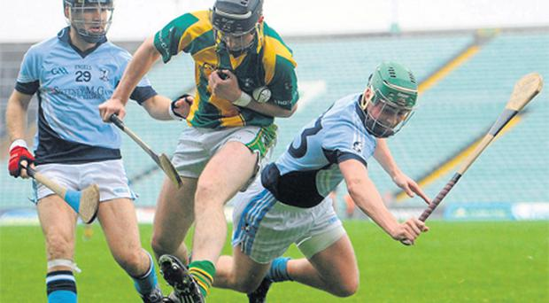 Ahane's Paraic Treacy in action against Damien Quigley, left, and David Lynch of Na Piarsaigh at the Gaelic Grounds yesterday