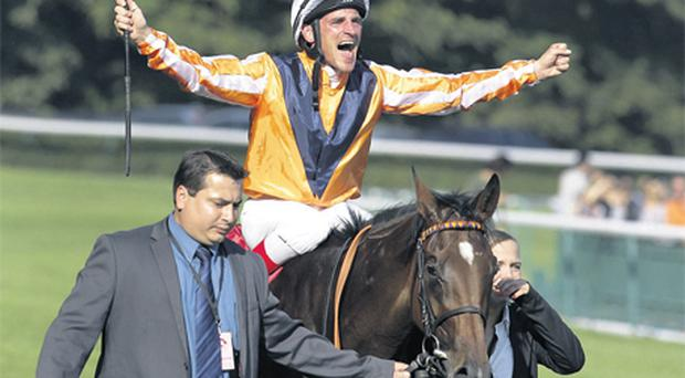 Jockey Andrasch Starke shows his emotions after piloting Danedream to victory in yesterday's Prix de l'Arc de Triomphe