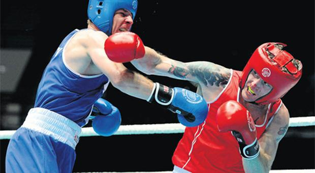 Roy Sheehan exchanges punches with Croatia's Borna Katalinic on his way to victory in Baku