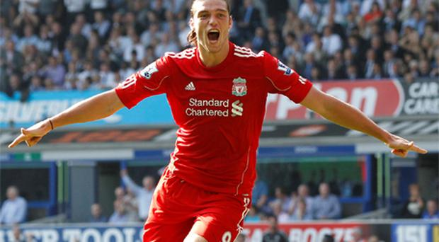 Andy Carroll celebrates after scoring Liverpool's opening goal in the Merseyside derby on Saturday. Photo: Reuters