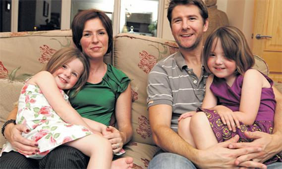 Zoe and David Woodrow with their daughters Lana and Emily at home in Balgriffin, Dublin