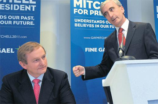 Presidential candidate Gay Mitchell with Taoiseach Enda Kenny at Trinity College, Dublin, yesterday