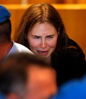 Amanda Knox breaks into tears after hearing her conviction for murdering Meredith Kercher was overturned. Photo: Getty Images