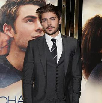 Zac Efron is happy to ditch his clean cut image for Seth Rogen's film