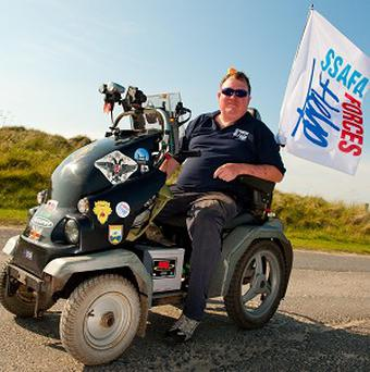 Former Corporal Mark Newton claims to have broken the world record for the longest distance travelled on a mobility scooter in 24 hours