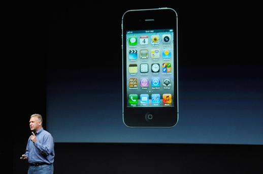 Apple's Senior Vice President of Worldwide product marketing Phil Schiller introduces the new iPhone 4s. Photo: Getty Images