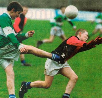 Keith Earls (in red and black) playing GAA in his younger days