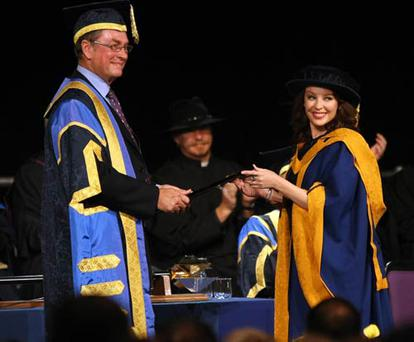 Singer Kylie Minogue, smiles as she receives her honorary degree