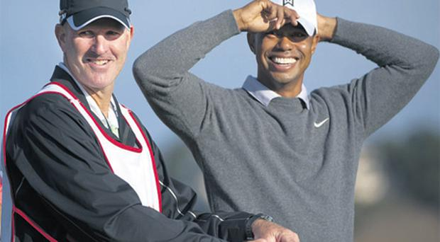 Tiger Woods stands with his new caddie Joe LaCava during the Pro Am of the Frys.com Open which starts today