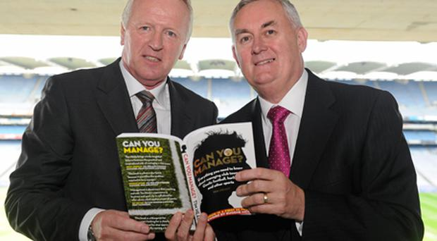 GAA President Christy Cooney (right) with Tim Healy at the launch of his book 'Can You Manage?'