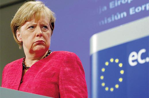 German Chancellor Angela Merkel addresses a news conference at the European Commission headquarters in Brussels yesterday