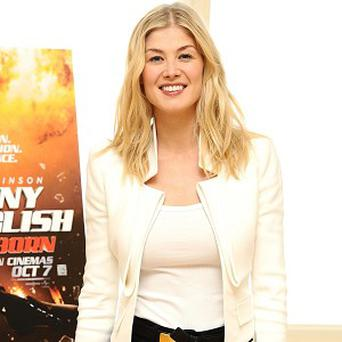 Rosamund Pike has praised her latest co-star Tom Cruise