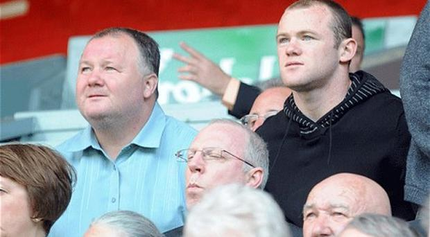 Under investigation: Wayne Rooney's father has been confirmed as one of nine men arrested in a betting probe