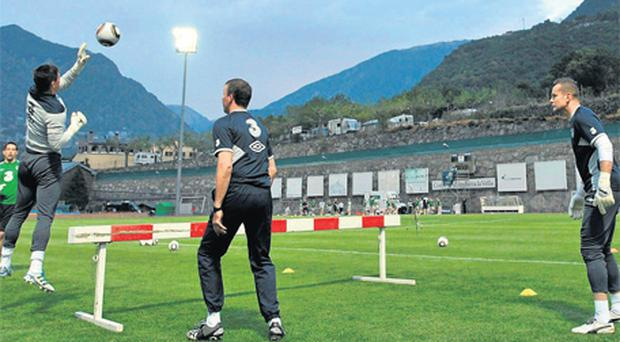 Goalkeepers David Forde, Kieran Westwood and Shay Given train alongside coach Alan Kelly (centre) at the Estadi Comunale in Andorra yesterday