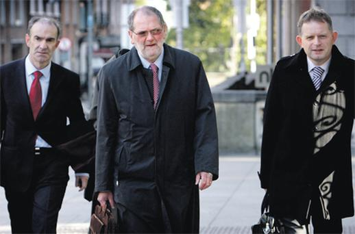 National Treasury Management Agency chief John Corrigan (centre) and other members of the NTMA team arriving at Kildare St yesterday for the hearing of the Public Accounts Committee into national debt management