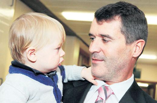 Oscar Jefferson (11 months), from Cobh, eyeballs Roy Keane at the opening of the Irish Cancer Society Daffodil Centre yesterday. Photo: DIANE CUSACK