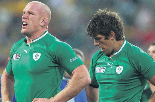 Paul O'Connell and Donncha O'Callaghan look shocked after Ireland's Rugby World Cup quarter-final defeat to Wales in Wellington yesterday. Photo: Cameron Spencer
