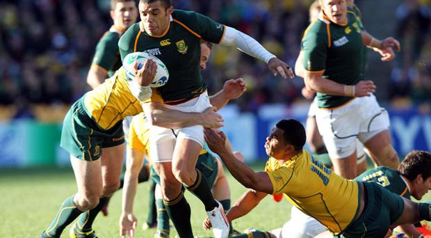 South Africa's Bryan Habana tries to get through the Australian defence. Photo: PA