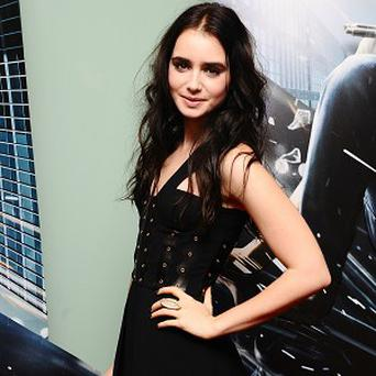 Lily Collins says she doesn't feel threatened by the rival Snow White film
