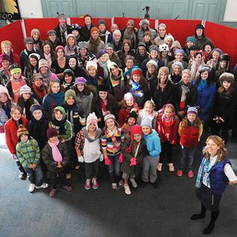 Singers of the charity song Meet Me In Winter in Wotton-under-Edge, Gloucestershire, seeking to challenge X Factor for the Christmas Number One spot (Barry Batchelor/PA)