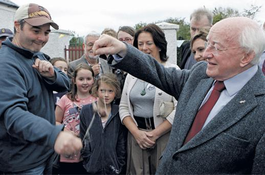Presidential candidate Michael D Higgins plays Colm McEntee at conkers during canvassing in Airfield, Dundrum, Dublin