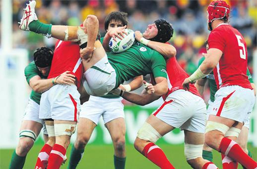 Stephen Ferris is picked up and driven back by the Welsh defence during Saturday's World Cup quarter-final
