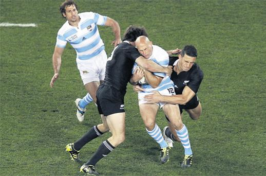 Argentina's Felipe Contepomi becomes the meat in an All Blacks sandwich as he is tackled by New Zealand duo Conrad Smith and Sonny Bill Williams