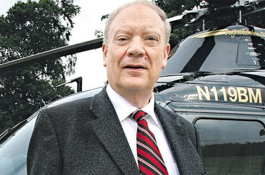 Jim Mansfield with his helicopter outside his Citywest hotel in 2008
