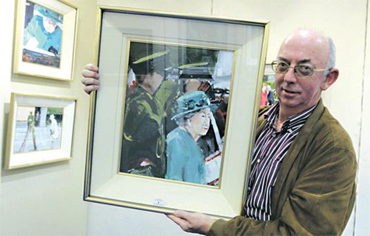 Michael Hanrahan with his paintings of Queen Elizabeth before the Whyte's auction last night