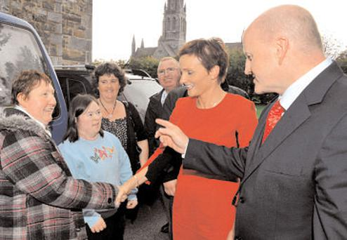 Sean Gallagher with wife Trish O'Connor (in red) on the campaign trail in Killarney yesterday