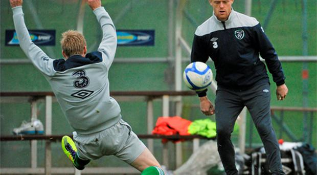 Damien Duff chips a pass over Andy Keogh in training yesterday