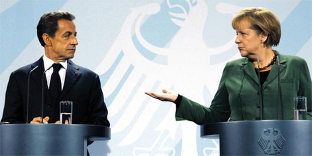 French President Nicolas Sarkozy and German Chancellor Angela Merkel at a news conference in Berlin