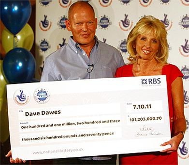 Dave and Angela Dawes from Wisbech, Cambridgeshire with their cheque for over £100m