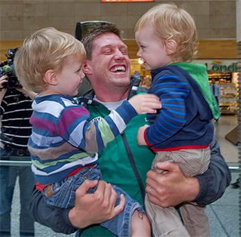 Ronan O'Gara arrives home from the World Cup to be greeted by his sons JJ and Rua at Cork Airport