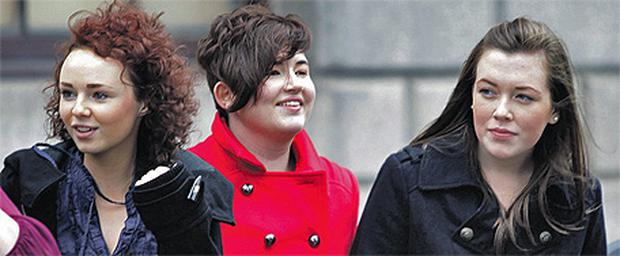 Left to right, Mairead O'Reilly, Roisin Ward and Aoife Fox leaving court yesterday after settling their defamation action