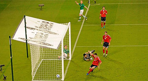 Kevin Doyle looks on as Valeri Aleksanyan puts the ball into the net for Ireland's first goal