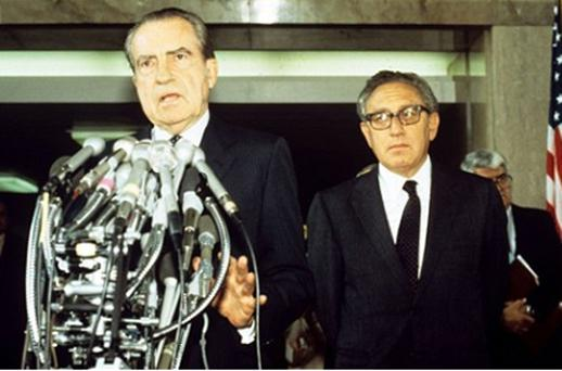 'A slightly menacing twinkle': Henry Kissinger (right) with Richard Nixon