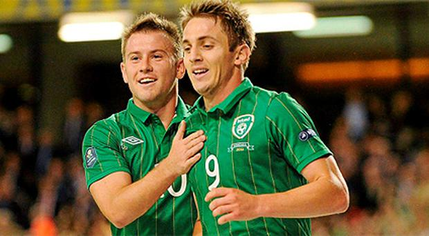 Kevin Doyle, right, will miss the first play-off game due to suspension, while Simon Cox was Ireland's man of the match against Armenia