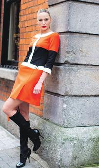 Sarah Morrissey models a 60s shirt dress with stretch knee-high boots