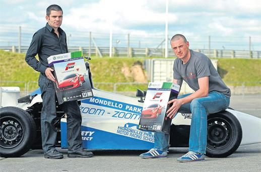 Kerry footballer Kieran Donaghy (right) and retired former world boxing champion Bernard Dunne lined out yesterday to unveil the latest instalment of Forza Motorsport 4 at Mondello Park