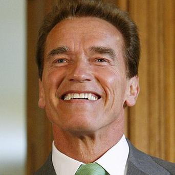 Arnold Schwarzenegger is enjoying being back on a film set