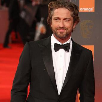 Gerard Butler is in line for a role about SEALS officers