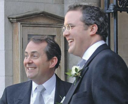 British Defence Minister Liam Fox with his best man and adviser Adam Werritty (right).