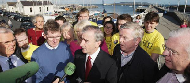 Presidential candidate Gay Mitchell (centre) canvases with Fine Gael colleagues on the East Peir in Dun Laoghaire. Photo: PA