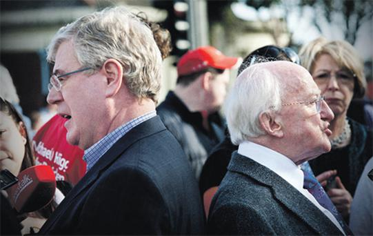 Tanaiste Eamon Gilmore and Labour's presidential candidate Michael D Higgins canvas in Dun Laoghaire yesterday