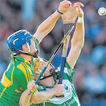 Clonoulty-Rossmore's John O'Keeffe grapples with Seamus Callanan during yesterday's Tipperary SHC Final at Semple Stadium