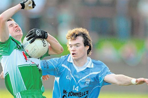 Colm Judge of Newtown Blues challenges St Patrick's Aidan McCann during yesterday's Louth SFC final