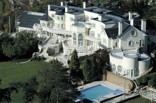 The plush exterior of Updown Court in Windlesham, Surrey, which was bought by an Indian businessman